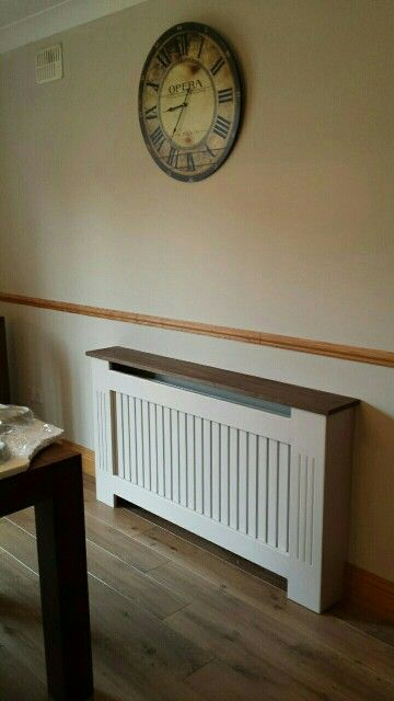 Modern radiator cover with walnut top to match floor.