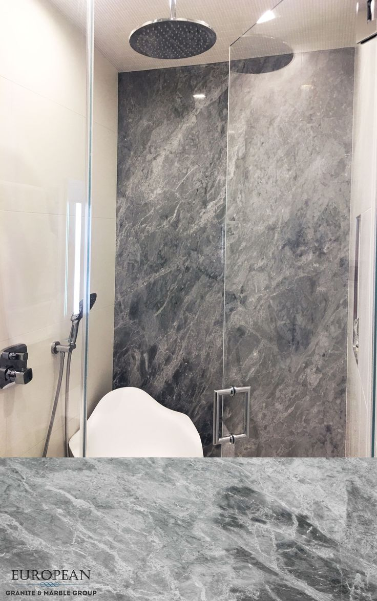 Gem granite bathrooms - This Stunning Blue De Savoie Marble Feature Wall Is The Focal Point Of This Bathroom The Spectacular Beauty Of The Marble Is Displayed In Its Full Glory