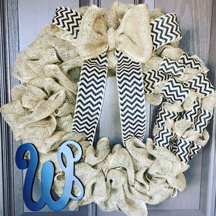 Burlap initial wreath by ThereSaWreath on Etsy https://www.etsy.com/listing/266034622/burlap-initial-wreath