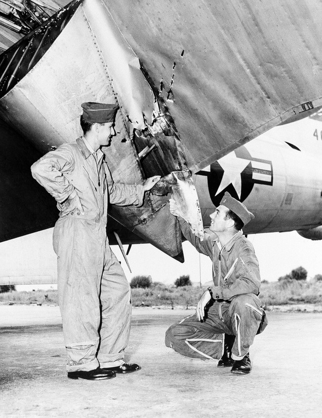 Air forces officers at base on Okinawa inspect damage to wing flap of B-29 which returned safely from Korean mission despite attack by Russian-built MIG fighter on June 9, 1951. The big ship sustained these lacerations in the flap but came home safely. At left is Capt. Donald M. Covic, 343 Chadron Ave., Chadron, Nebr.,and Lt. David P. Self, pilot, of 509 S. 17th St., Salt Lake City, Utah. (AP Photo)Wings Flap, Historical Photos, Marissa Okinawa, Lakes Cities, Salts Lakes, Okinawa Trips, Conflict 1950, Salt Lake City, Korea Conflict