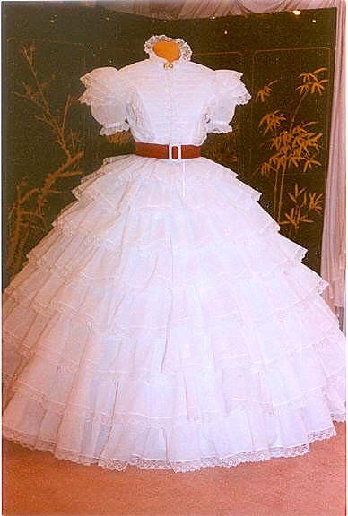 Scarlett's white dress in the opening scenes of the movie. The costumes were designed by Walter Plunkett.