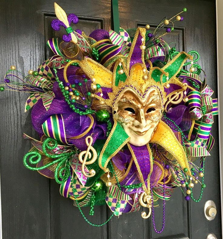 Mardi Gras deco mesh wreath, Mardi Gras decorations, Mardi Gras decor, Mardi Gras Wreaths What a great way to greet your friends and family with this Mardi Gras deco mesh wreath for your party or get together. Wreath is made with premium gold, purple, and green foil deco mesh. There is a gorgeous mask and a fleur-de-lis in purple, gold, and green adorning this beautiful wreath. Also there are many gold, green, and purple ribbons and pics. Wreath measures approximately 28-29inches. Thanks for…