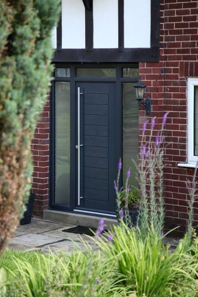 Grey Palermo composite door with integrated top and side lights and satin glass.