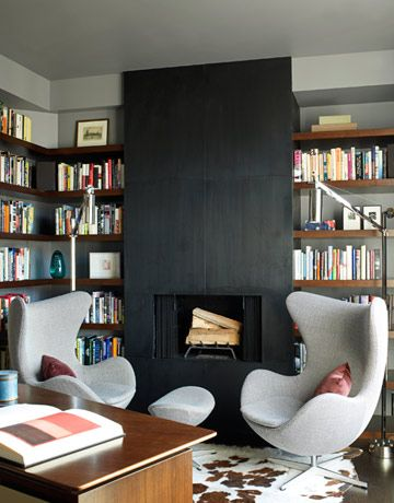 The juxtaposition of these open, wooden book shelves with the minimal black hearth is fantastic. Interior Design and Decor