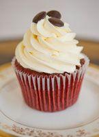 moist red velvet cupcake topped with cream cheese buttercream
