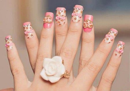 Floral Nail Art Design gives life to your nails. By adding white polish on the tips with flower details  on them. Don't forget to add simple stones or glitters or embellishment on top to highlights the details .
