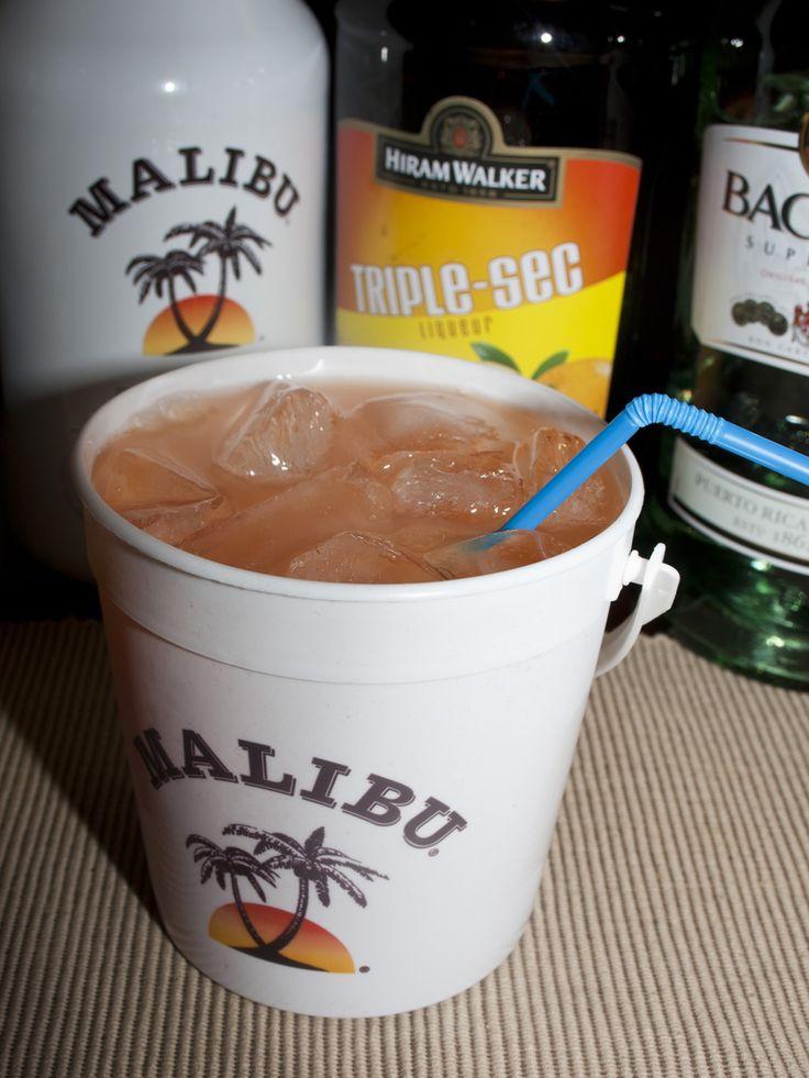 Pirate's Punch:  2 ounces Malibu Rum  2 ounces white rum  2 ounces triple sec  2 ounces creme de banana (or 99 bananas brand)  2 ounces pineapple juice  2 ounces orange juice  floater of dark rum  teaspoon – tablespoon grenadine