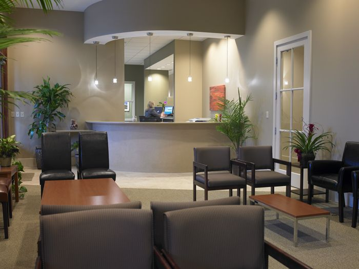 office waiting room design. waiting roomchair placementneutral walls with pops of green plants office room design