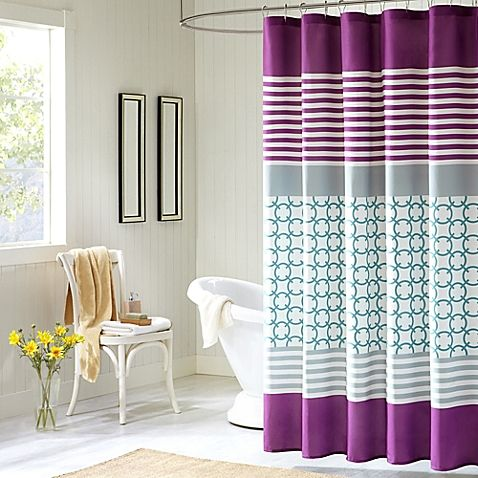 Accentuate your bathroom with the Halo Shower Curtain from Intelligent Design. Featuring teal and white checkered prints and horizontal purple stripes with a bold purple stripe running along the bottom, this curtain is made of 100% polyester.