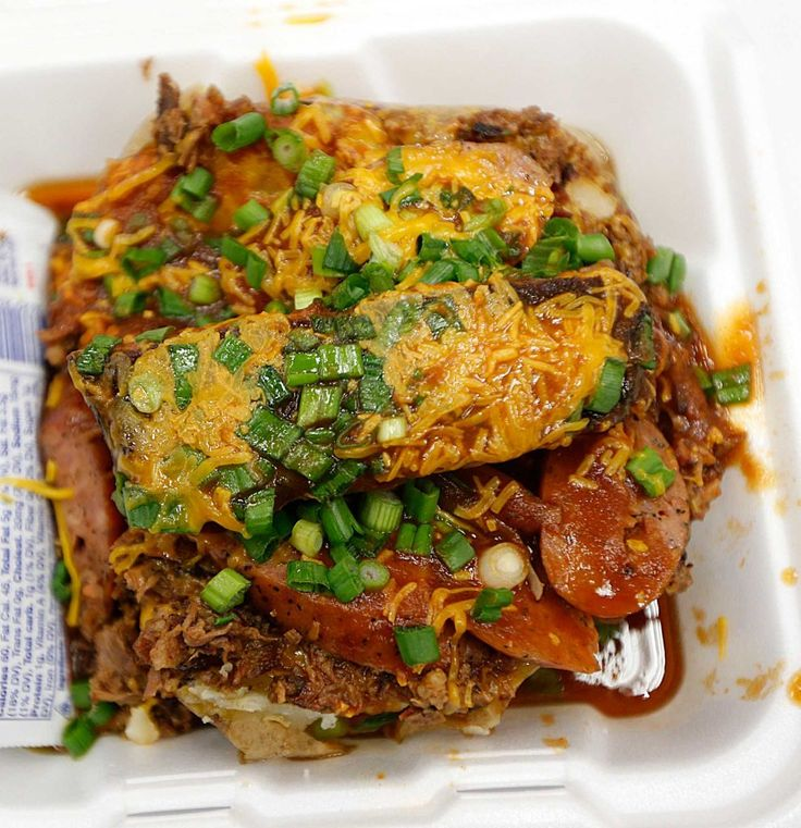 Taters and three kinds of meat collide in this massive loaded baked potato from Triple J's.