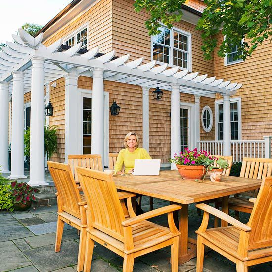Pergolas look great in the landscape, but they can also be a great accessory for your home. This smart pergola, for example, adds a fun architectural detail to the house./