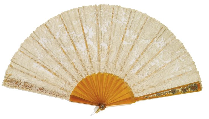 A Fabergé lace and tortoiseshell fan with jewelled gold mounts, probably workmaster Michael Perchin, St Petersburg, circa 1890, the front guard applied with chased gold rocaille scrolls and trellis and set with rose-cut diamonds, the leaf of hand-embroidered Flemish linen lace, the sticks carved with leaf trails, gold scroll loop.
