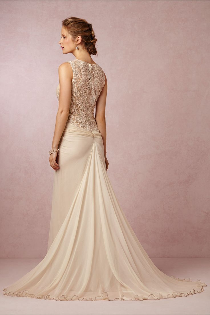 Flora Gown from BHLDN-- Constructed of crinkled silk chiffon and lace, this softly contoured gown from Tadashi Shoji gathers at the center to create an hourglass shape, then flows softly at the back into an elegant train. Tiny lightweight beads are placed overtop the lace and catch the light in the prettiest way.