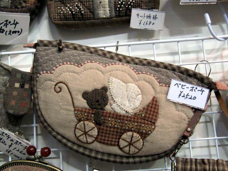 Patchwork bag...this woman has the prettiest appliquéd purses.this appliqué is for inspiration only! Isn't it quaint?!