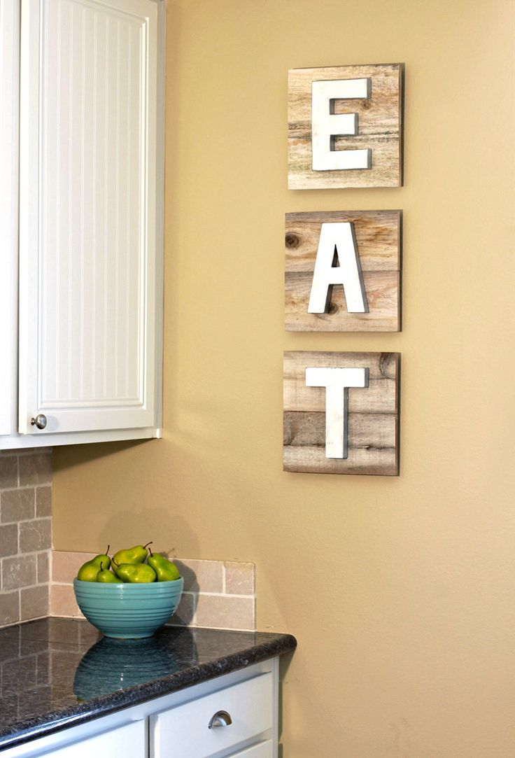 EAT Sign on Reclaimed Wood with Dimensional Painted Metallic Letters