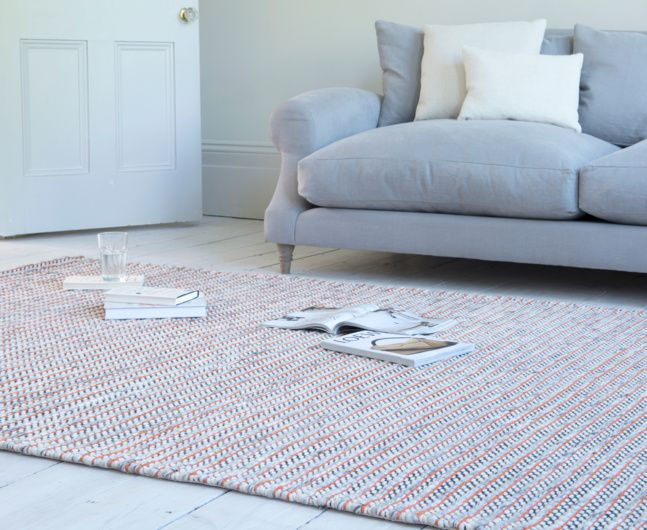 The gorgeous Crumbs is a bright flatweave floor rug. This rug is a real winner thanks to its lovely burnt orange and neutral grey mix.