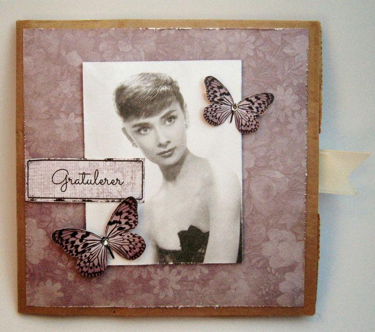 Kort & Godt Galleri: Papirpose, ett ark, rester med stasj, stiftemaskin...