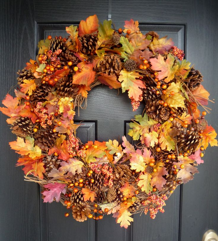 Plump Harvest Wreath-leaves, pinecones, and berries on grapevine base. Nicely done.