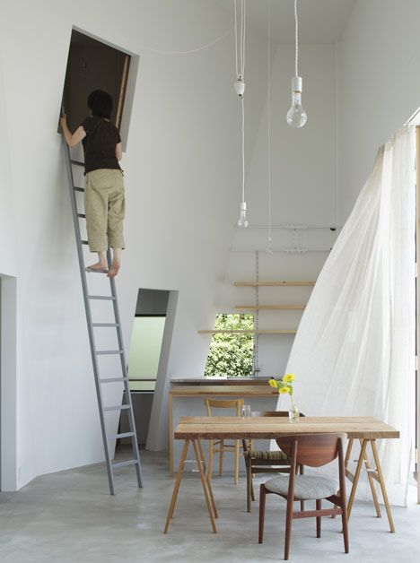 The bedroom in this house for rock-climbers is reached via a ladder.