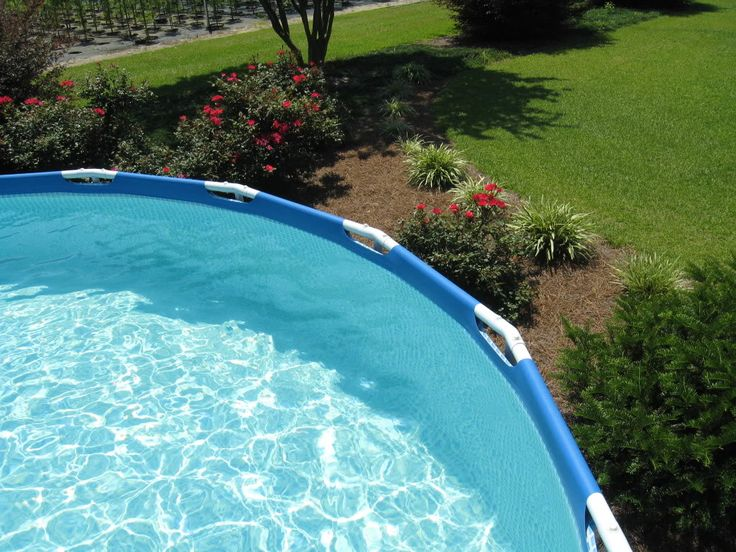 Above Ground Pool Landscape Designs | ... the very base of my pool but the rest is landscaped with shrubbery and