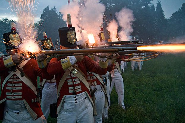 British redcoat Reenactors from the War of 1812 - I know it's a re-enactment, but did their weapons really flare like that?