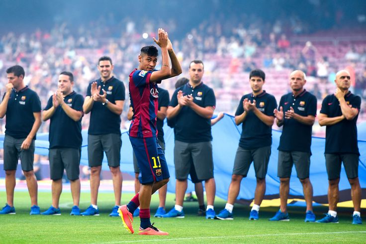 Neymar of FC Barcelona waves during the official presentation of the FC Barcelona prior to the Joan Gamper Trophy match between FC Barcelona and Club Leon at Camp Nou on August 18, 2014 in Barcelona, Catalonia.