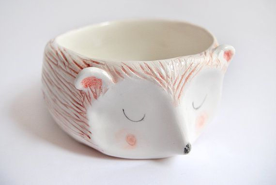 Super cute hedgehog bowl, decorated with pigments with little details in pink, brown and black colors. It is made of white clay, decorated with