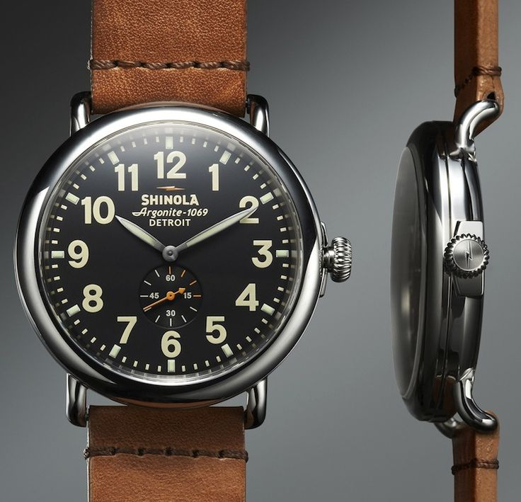 THE RUNWELL BY SHINOLA with a Swiss Argonite 1069 Movement, a stainless steel case and it's all handmade in Detroit. From a design perspective, the watch has a classic pre-WWII design with a minimalist dial and a water-resistance rating of 5ATM