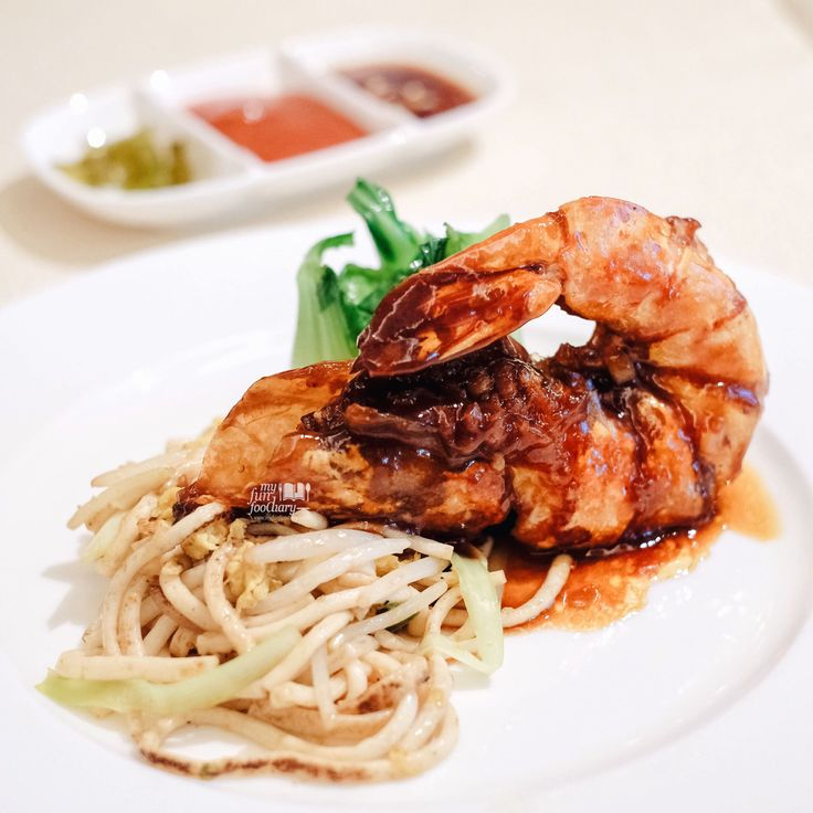 Pan-fried King Prawn with Superior Soy Sauce served with fish noodle and baby cabbage, by the Executive Chinese Chef Ku Keung at Golden Peony, Conrad Singapore. Read more: http://bit.ly/goldenpeonyconrad?utm_campaign=coschedule&utm_source=pinterest&utm_medium=Mullie%20Marlina&utm_content=%5BSINGAPORE%5D%20Luxury%20and%20Memorable%20Stay%20at%20Conrad%20Centennial%20Singapore