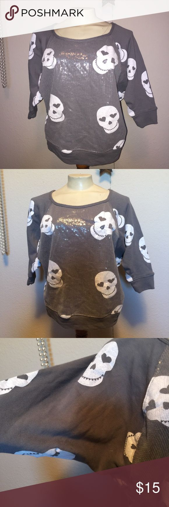 Gray skull dolman batwing shirt top Cute gray skull dolman batwing shirt top size xl.  ~ I am open to reasonable offers. ~I do my best to describe each item thoroughly. If something is missed it is completely unintentional.  ~Be sure to check out my other listings for more great items & save on shipping! ~I ship same day or next day.  ~ I do not hold items.   ~Not responsible for incorrect sizing. I go by what the tag says its up to the buyer to know their size. Hard Candy Tops Sweatshirts…