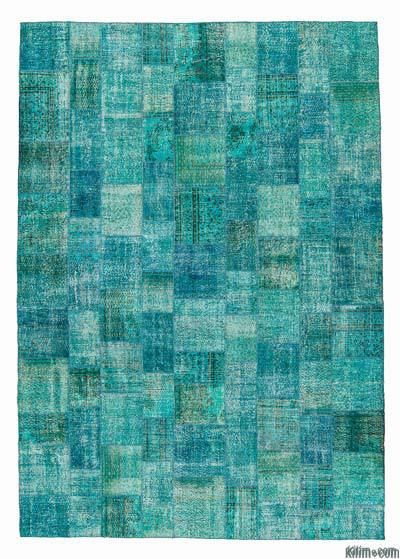 Over-dyed Turkish patchwork rug created by first neutralizing the colors and then over-dying to turquoise to achieve a contemporary effect and bring old hand-made rugs back to life. This over-sized rug is 11'5'' (348 cm) x 16'5'' (500 cm) and it is backed with cotton cloth as reinforcement.