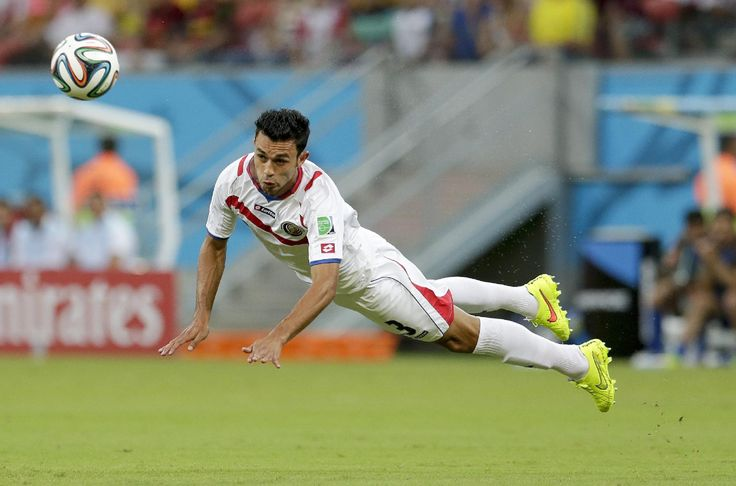 Costa Rica's Giancarlo Gonzalez passes the ball with a header during the World Cup round of 16 soccer match between Costa Rica and Greece at the Arena Pernambuco in Recife, Brazil, Sunday, June 29, 2014.