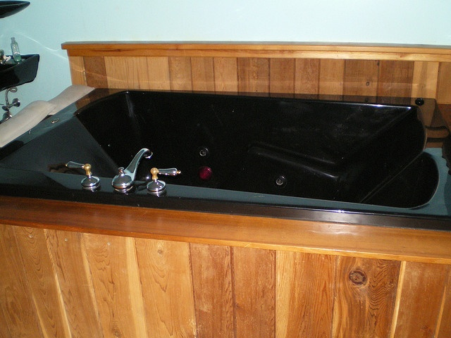this is the hot tub in our basement it is ours to use with the