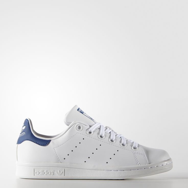 Stepping into a pair of Stan Smiths is a rite of passage. This kids' version of the iconic adidas court shoe brings smooth, clean style to people with smaller feet. Sleek full-grain leather, subtle perforated 3-Stripes, and a tonal rubber outsole all keep the look sleek and classic on this low-top legend created for 1970s tennis star Stan Smith.