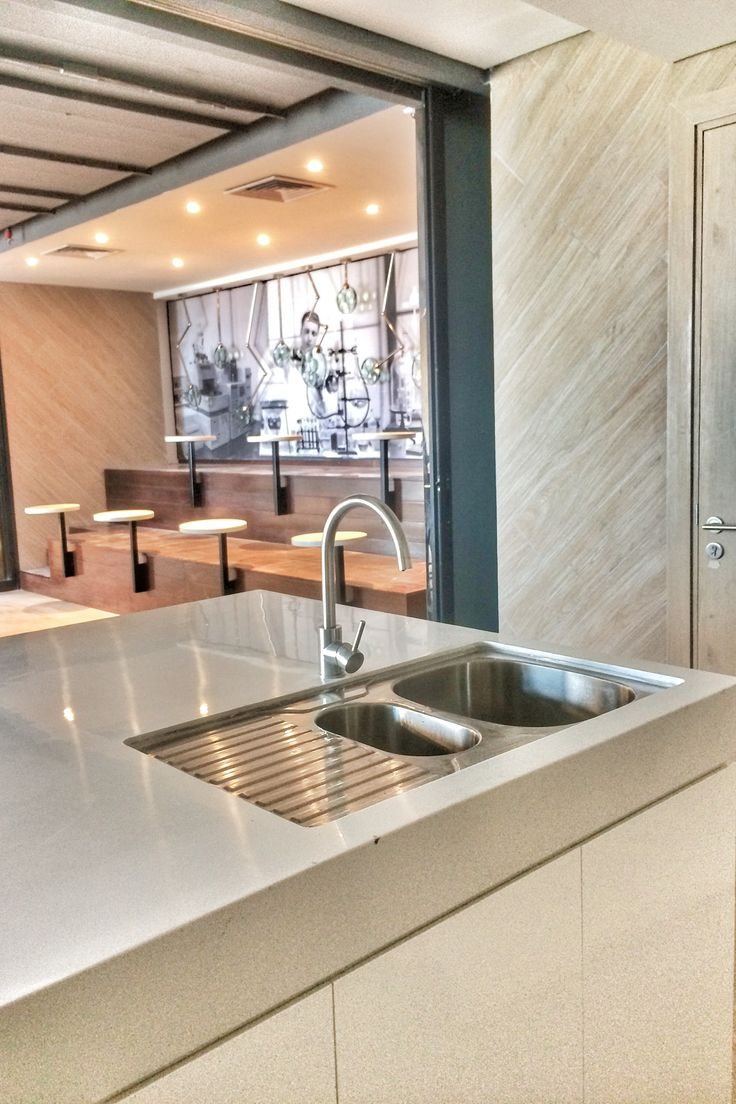 Kitchen sink with solid surface table.
