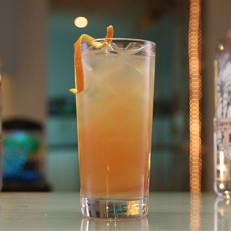 LIQUID PANTY DROPPER 1/2 oz. (15ml) Vodka 1/2 oz. (15ml) Gin 1/2 oz. (15ml) Coconut Rum 1/2 oz. (15ml) Peach Schnapps 1/4 oz. (7.5ml) Triple Sec 2 Splashes Cranberry Juice 2 Splashes Pineapple Juice Top with Orange Juice  Garnish: Orange Twist  PREPARATION 1. Fill a collins glass with ice.  2. Add all ingredients. Garnish with orange twist. Enjoy! DRINK RESPONSIBLY!