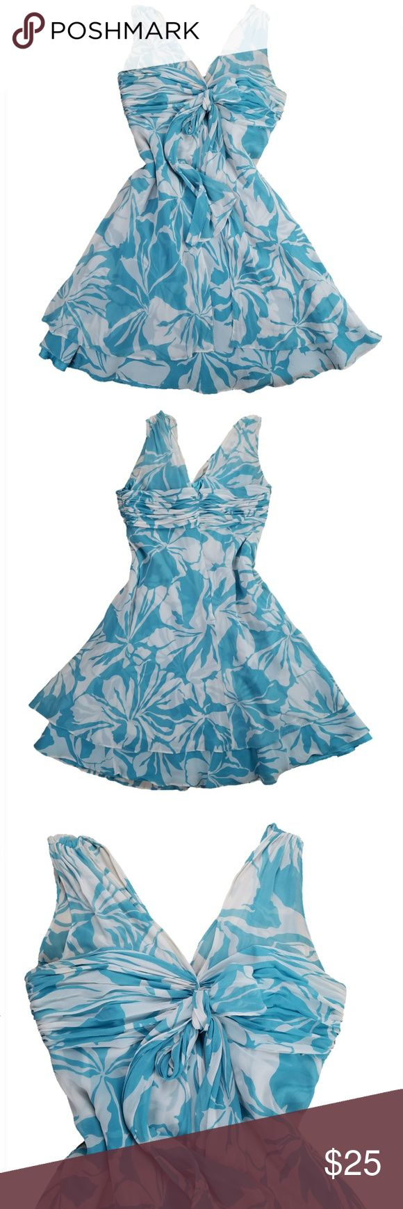 """DONNA RICCO Tropical Floral Silk Knee Length Dress Size: 12  Color/Pattern: Teal/Turquoise & White; Tropical Floral Design: Sleeveless, V-neck, Empire Waist, Circle Materials: Shell: 100% Silk; Lining: 100% Polyester  Measurements (approximate, laying flat) Shoulder (seam to seam): 16"""" Underarm to underarm: 19"""" Waist: 17"""" Length: 40"""" Width at Hem: 38""""  Condition: Gently pre-owned with no tears, holes, or stains.  PLEASE CHECK MEASUREMENTS TO ENSURE PROPER FIT!  I am a smoke-free, Dog…"""