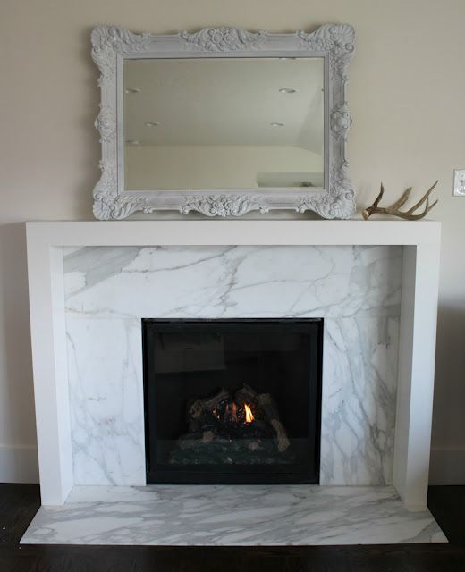 Fireplace. White, clean lines. Love. Via 4 Men 1 Lady: Evolution of a fireplace.