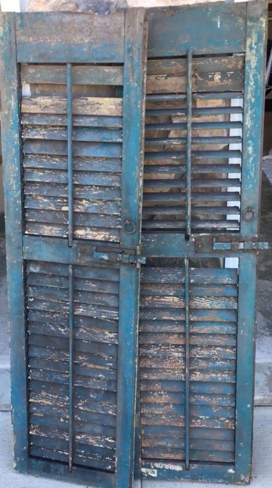 I found these awesome shutters at our local antique store and knew I could use them in my bedroom remodel. They had the original hardware and most of the slates…