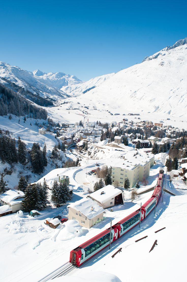 The Swiss mountain village Andermatt in winter. Imagine being on that train!