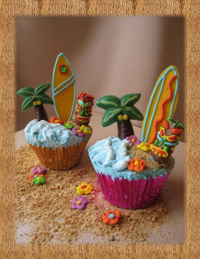 luau party cupcakes: Waves with tip #104. Sand is crushed graham crackers. Palm trees are candy melts, mold from MIchaels. Surfboard is piped candy melts, outlined with RI. Tiki is tootsie roll, piped with RI. RI flowers. Lollipop sticks to keep items upright. Thanks to Boshellbug for inspiration.