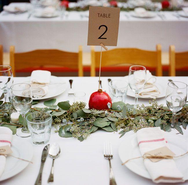 pomegranate table decor makes for simple + pretty decor!