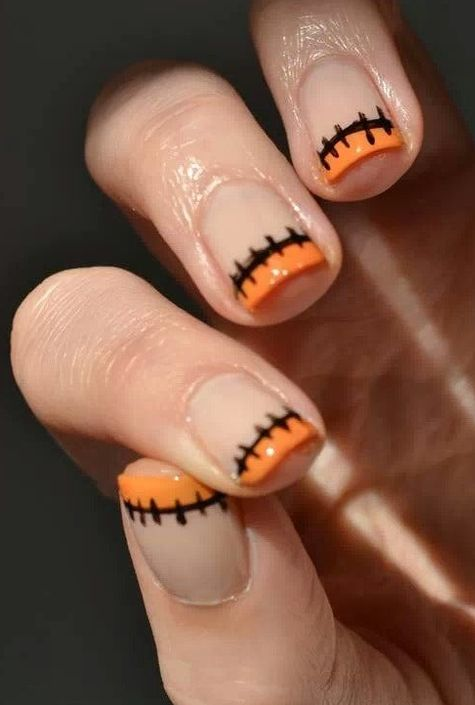 A cute spooky spin on the classic French manicure.