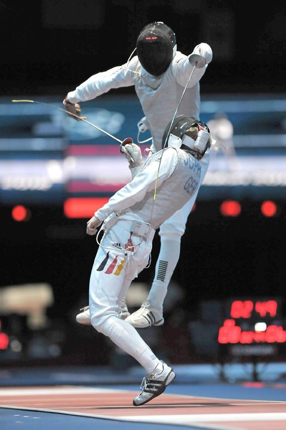 """Fencing - London, 2012. I must say that fencing has become more of an """"airborne"""" sport than was practiced when I was in my prime with the Italian foil. (I won a gold medal in a NY competition.) My father put an Italian foil in my hand at age 7 & told me that I was going to learn to fence! Period. This """"flying through the air"""" was never seen at matches in my day. The balestra lunge was considered """"flashy"""" & boy, was your face red when it backfired!"""