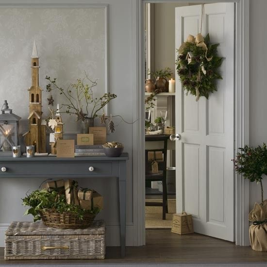 Rustic grey Christmas hallway with natural foliage decorations