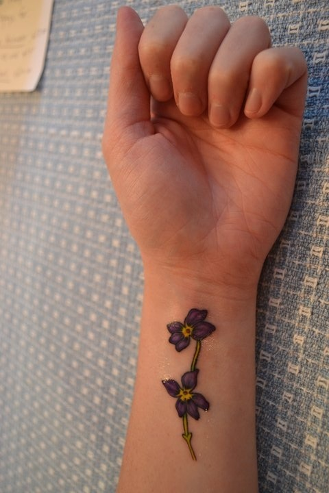 "Two violets, based on the Mark Twain quote, ""Forgiveness is the fragrance that the violet sheds on the heel that has crushed it."" It was done at Sleepy Hollow Tattoo in Milford, CT"