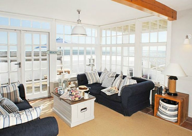Coastal Navy Slipcover Sofas And Vast Ocean View From This