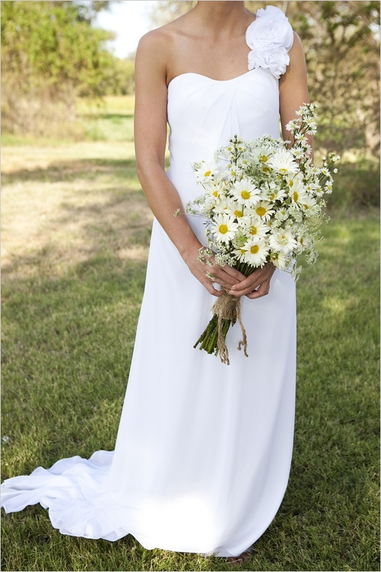 I definitely want some yellow and white daisies to be a part of the bouquets. I pinned this because it reminds me of wildflowers, but I would want mine to be more formal and round than this.
