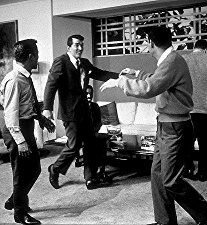 """Ocean's Eleven,"" stars stage a fight. Akim Tameroff, Sammy Davis Jr., Dean Martin, & Joey Bishop, 1960."