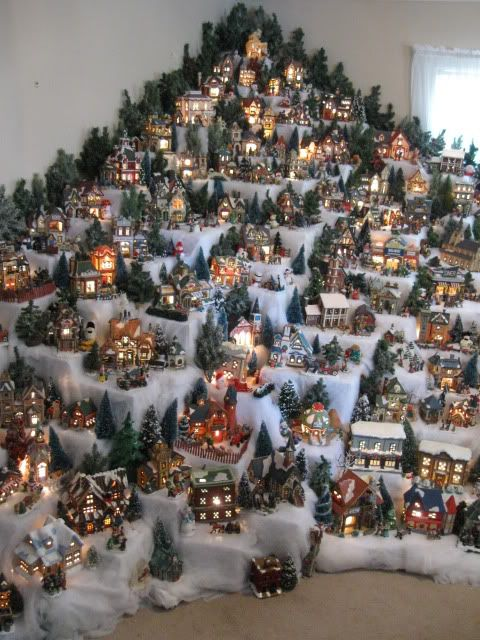 snow village setup an a mountain display a clever way to see the details of each building the tree lined edges frames it nicely too christmas
